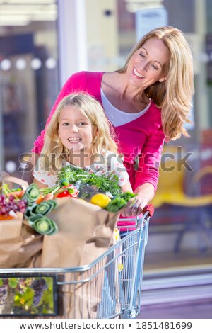 Little caucasian girl with her shopping trolley. Stock photo © RAStudio