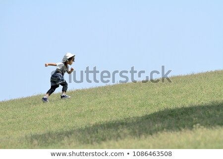 Three girls running down hill Stock photo © IS2
