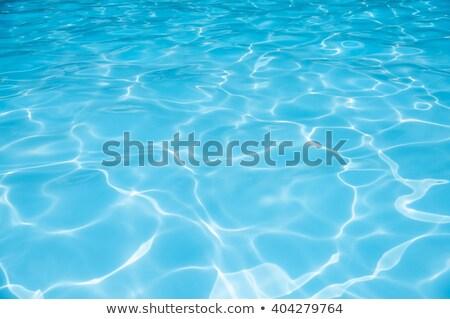 Ripple Water in swimming pool witn sun reflection Stock photo © artjazz