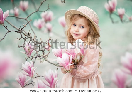 Pequeno loiro menina posando azul inverno Foto stock © acidgrey