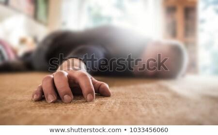 Inconscio uomo piano giovane soggiorno casa Foto d'archivio © AndreyPopov