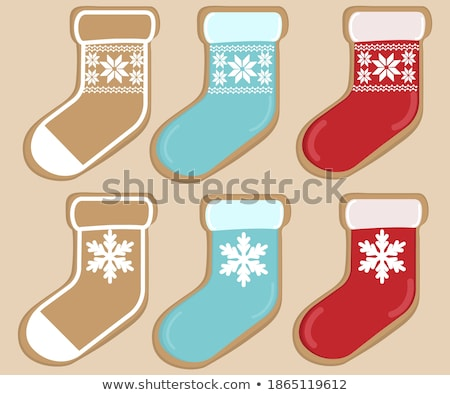 Christmas toy form of red winter sock with sweets, gifts and colorful baubles isolated on white back stock photo © Lady-Luck