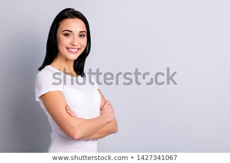 Young cheerful businesswoman of Asian ethnicity crossing arms by chest Stock photo © pressmaster