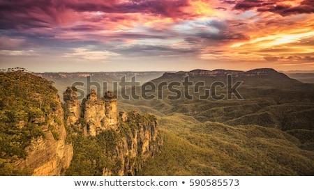 Paisagem pôr do sol azul montanhas belo dramático Foto stock © vapi