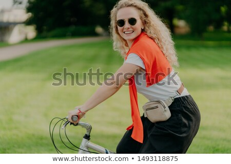 Horizontal tiro feliz rizado mujer moto Foto stock © vkstudio