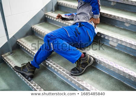 Worker Man Lying On Staircase Stock photo © AndreyPopov