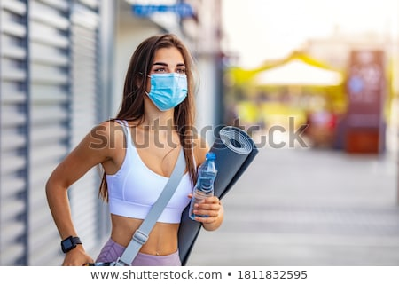 Stock photo: Woman trying to do sport during coronavirus crises despairing of the world