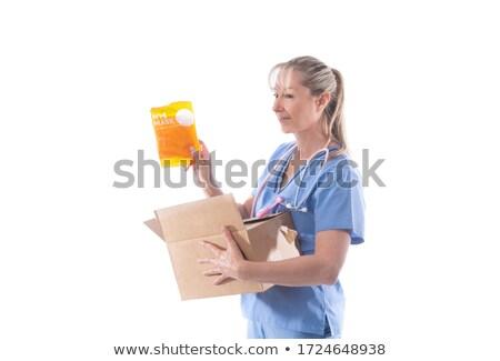 A nurse holds a box of N95 respirator masks Stock photo © lovleah