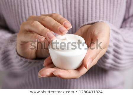 Woman holding moisture cream. Stock photo © deandrobot