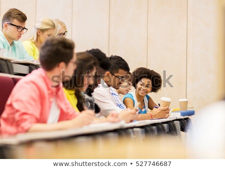 group of students with coffee writing on lecture Stock photo © dolgachov