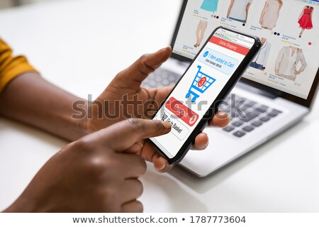 African Woman Using Online Ecommerce Shop Stock photo © AndreyPopov