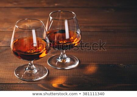 бренди очки бутылку старые деревянный стол древесины Сток-фото © goir