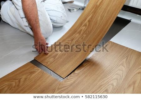Installing vinyl flooring Stock photo © Trigem4