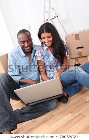 Metis couple using laptop at home Stock photo © photography33