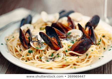 spaghetti with mussels stock photo © joker