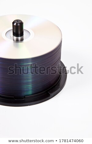 compact discs and burner on a white background  Stock photo © artush