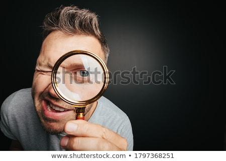 Foto stock: Homem · grande · olho · de · aumento · lente