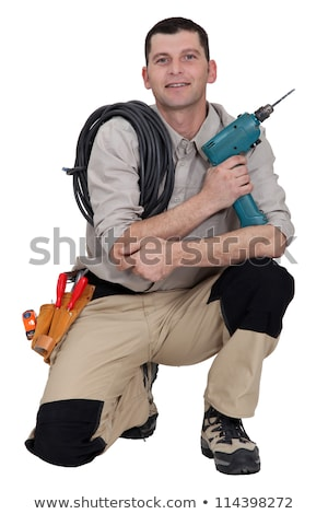Woodworker crouching on white background Stock photo © photography33