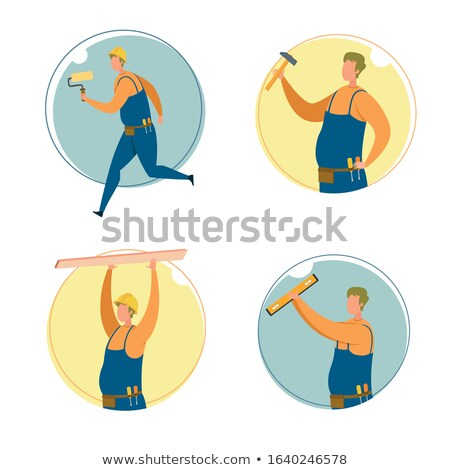 Handyman holding a hammer and carrying a wooden plank Stock photo © photography33