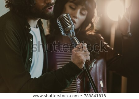 young couple with a microphone stock photo © photography33