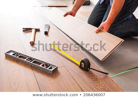 Man Installing New Laminate Wood Flooring Stock photo © feverpitch