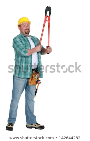 Tradesman holding up a pair of large clippers Stock photo © photography33