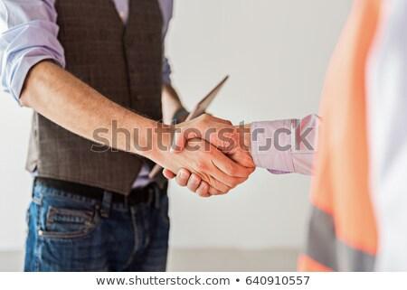 tradesman standing beside an engineer stock photo © photography33