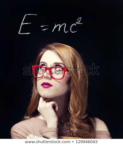 redhead student with blackboard stock photo © massonforstock