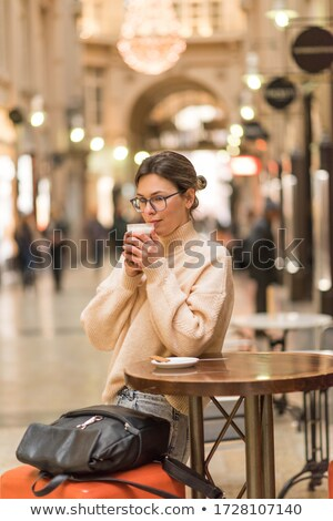 Girl is drinking latte in cafe. Stock photo © d13
