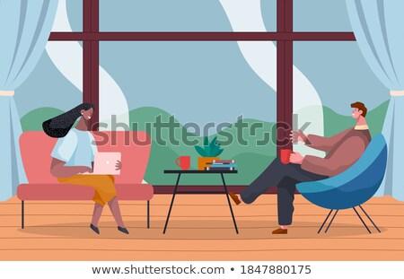 człowiek · posiedzenia · niebieski · krzesło · laptop · świadczonych - zdjęcia stock © kirill_m