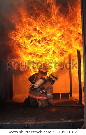 Firefighter fighting For A Fire Attack Stock photo © scenery1