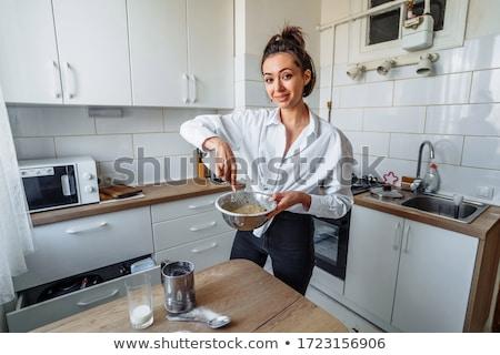 Jonge vrouw koken rauw voedsel dessert portret meisje Stockfoto © julief514