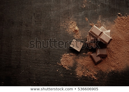 Chocolate pieces on wooden table Stock photo © nessokv