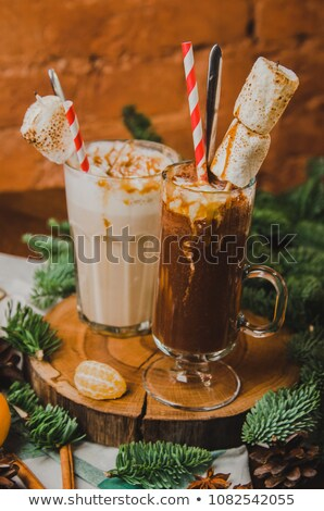 Cocoa and hot chocolate toppings spill from a glass jar Stock photo © sarahdoow