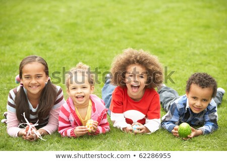 Group Of Children Laying On Grass With Easter Eggs Stock photo © monkey_business