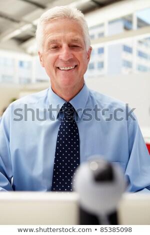 старший бизнесмен skype компьютер человека заседание Сток-фото © monkey_business
