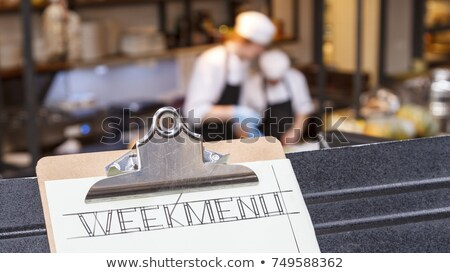 Man holding board with WEEKEND title Stock photo © stevanovicigor