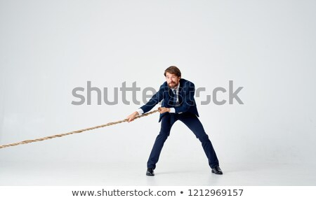 Businessman pulling a rope with effort Stock photo © wavebreak_media