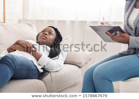 depressed patient lying on couch stock photo © wavebreak_media