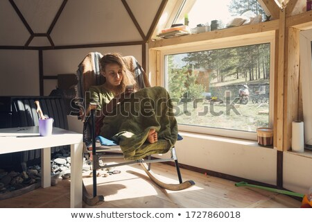 Happy young woman using cellphone relaxing in bubble chair Stock photo © deandrobot