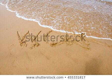 Nap varázsige írott munka homok tengerpart Stock fotó © lunamarina