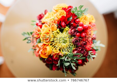 Elegance armchair and flower bouquet on table Stock photo © smuay