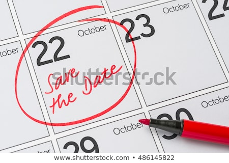 save the date written on a calendar   october 22 stock photo © zerbor