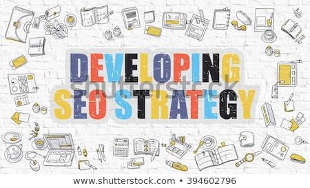 multicolor seo strategies on white brickwall stock photo © tashatuvango