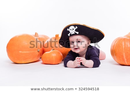 Cute baby with a pirate hat on his head lying on his stomach on  stock photo © Traimak