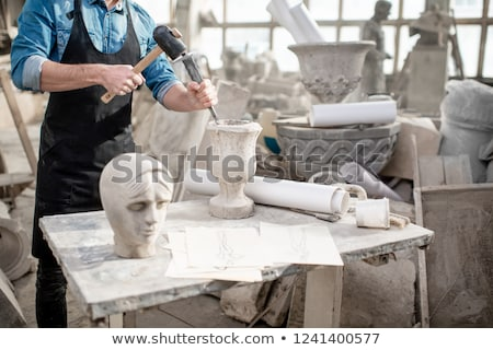 Man sculpting face in clay Stock photo © IS2