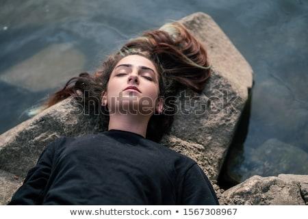 Woman lying on rock Stock photo © IS2