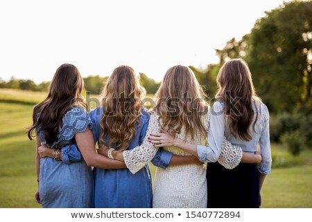 girls with arms around each other Stock photo © IS2