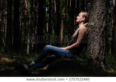 girl in woods against tree Stock photo © IS2