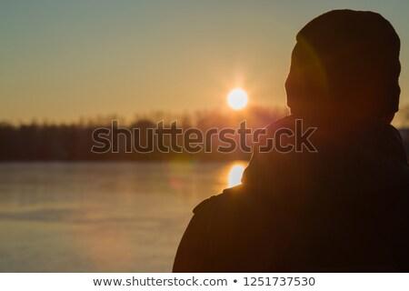 Man bevroren meer natuur ijs winter Stockfoto © IS2